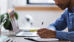 man, writing, laptop